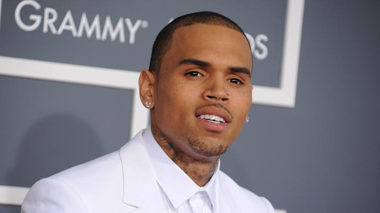 FILE - In this Feb. 10, 2013 file photo, Chris Brown arrives at the 55th annual Grammy Awards, in Los Angeles. A Los Angeles judge has dismissed a hit-and-run driving charge against singer Chris Brown. The judge said Brown had reached a civil compromise with the other driver and City News Service says the misdemeanor was dropped Thursday, Aug. 15, 2013. (Photo by Jordan Strauss/Invision/AP, File)
