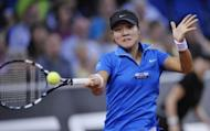 China's Li Na returns the ball to Poland's Agnieszka Radwanska during their quarter-final match at the WTA Porsche Tennis Grand Prix in Stuttgart. Li was first quarter-final casualty of the WTA clay-court tournament