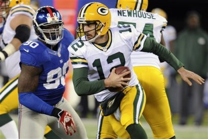 Aaron Rodgers isn't putting up the same mind-boggling numbers that he posted last season. (AP)