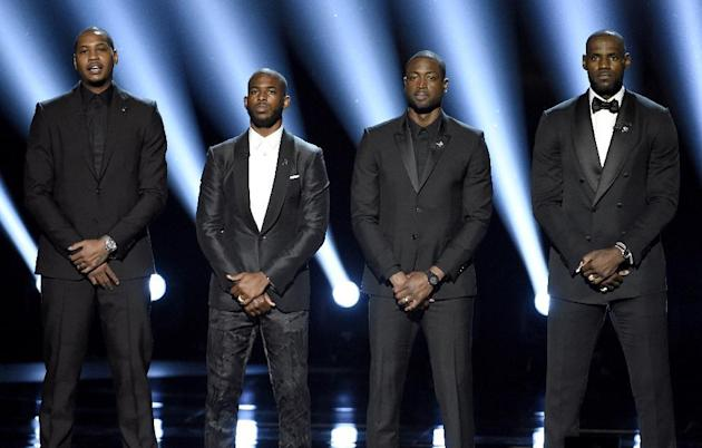 FILE - In this July 13, 2016, file photo, NBA basketball players Carmelo Anthony, Chris Paul, Dwyane Wade and LeBron James, from left, speak on stage at the ESPY Awards in Los Angeles. The four gave a