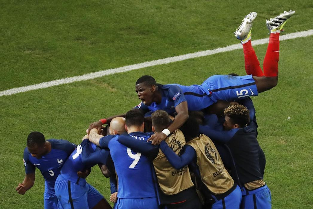 France's Antoine Griezmann celebrates scoring their first goal