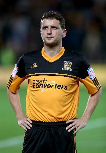 Hull City's Alex Bruce has opted to make the switch to represent Northern Ireland