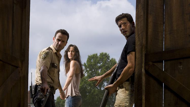 "Andrew Lincoln as Rick Grimes, Sarah Wayne Callies as Lori Grimes and Jon Bernthal as Shane Walsh on ""The Walking Dead."""