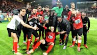 Guingamp's players celebrate after winning the French Cup match against Monaco (AFP)