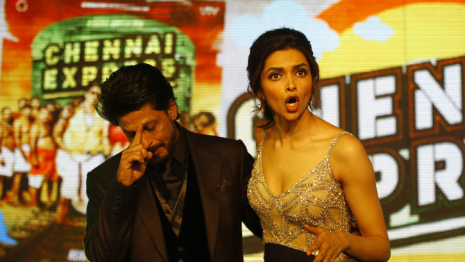 "Bollywood star Shah Rukh Khan, co actor Deepika Padukone reacts to media during the music release for his upcoming movie ""Chennai Express"" in Mumbai, India, Wednesday, July 3, 2013. Directed by Rohit Shetty, the film scheduled for release on August 8 features Khan and Padukone in lead roles. (AP Photo/Rafiq Maqbool)"