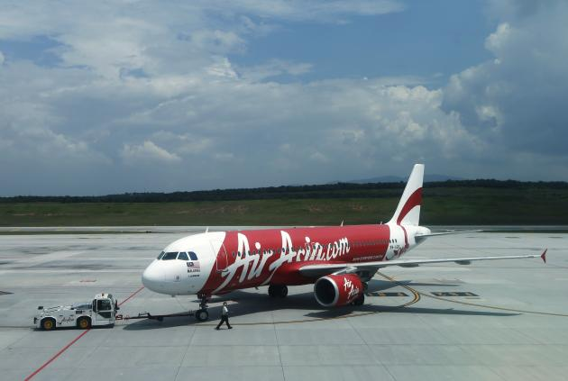 The missing AirAsia flight QZ8501 is similar to the jet seen here, a 9M-AQB model pictured on the track at Low Cost Carrier Terminal (LCCT) airport at Sepang outside Kuala Lumpur November 19, 2013.