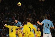 Manchester City's Gareth Barry (2nd L) climbs onto Reading's Nicky Shorey to score the winning goal during their Premier League match on December 22, 2012. City broke the deadlock when Barry headed home from a David Silva cross