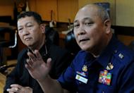 Philippine coastguard chief Rear Admiral Rodolfo Isorena (R) and Asis Perez, Bureau of Fisheries and Aquatic Resources chief, are pictured in Manila on May 10, 2013. The Philippine coastguard admitted Friday that its personnel shot at a Taiwanese fishing boat in an incident that authorities in Taipei said left a crewman dead