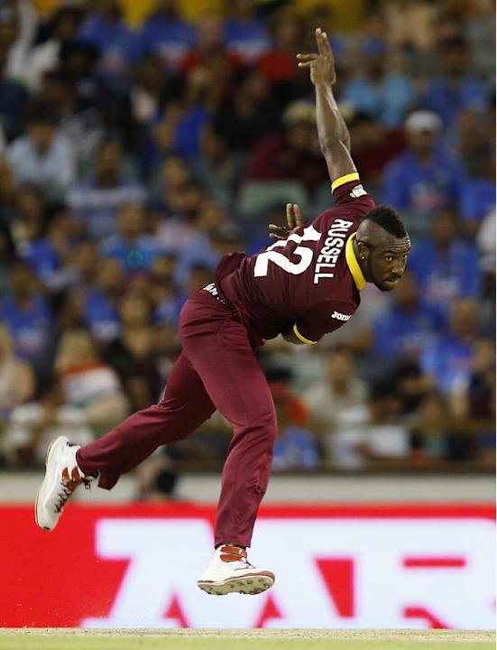 West Indies Andre Russell bowls a delivery during their Cricket World Cup Pool B match against India in Perth, Australia, Friday, March 6, 2015. (AP Photo/Theron Kirkman)