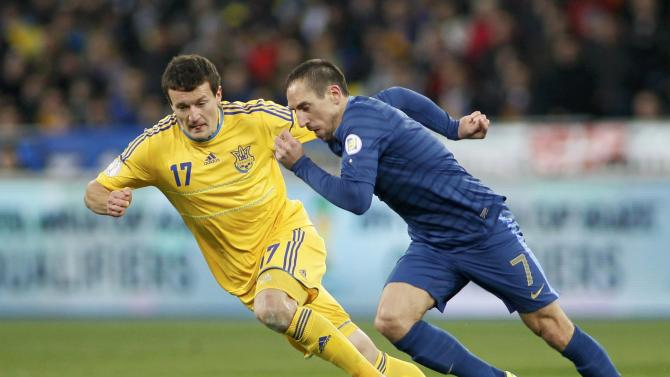 Ukraine's Artem Fedetskiy chases France's Franck Ribery during thei 2014 World Cup qualifying first leg playoff soccer match at the Olympic stadium in Kiev