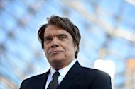 French tycoon Bernard Tapie before the start of a league match in Marseille, on May 26, 2013. French corruption investigators have seized the assets of Tapie, suspected of having committed fraud as part of an organised gang, judicial sources have said