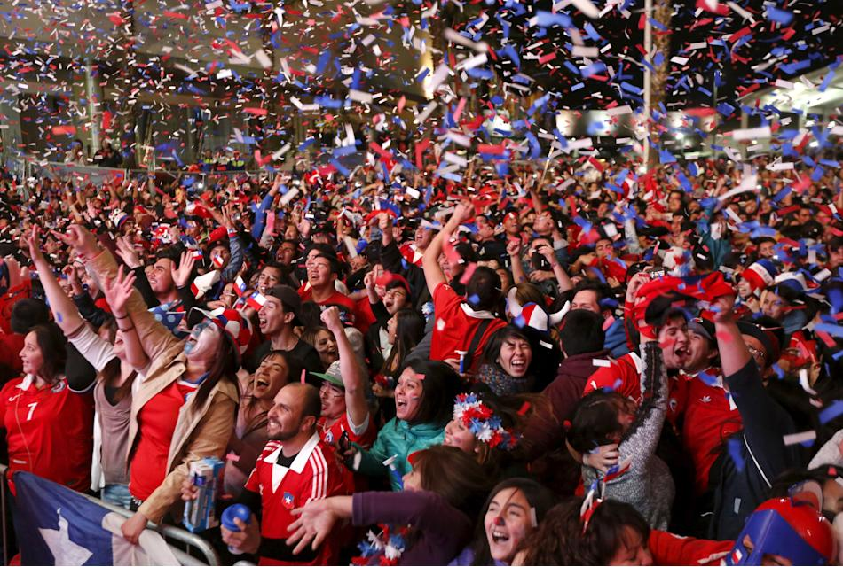 Chilean soccer fans react after winning Copa America 2015 final soccer match between Chile and Argentina at a fan fest in Santiago, Chile