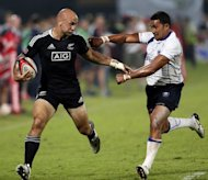 New Zealand's Dj J Forbes (L) fights for the ball with Samoa's Reupena Levasa during their International Rugby Board (IRB) Sevens World Series rugby union final match in Dubai. Samoa won 26-15