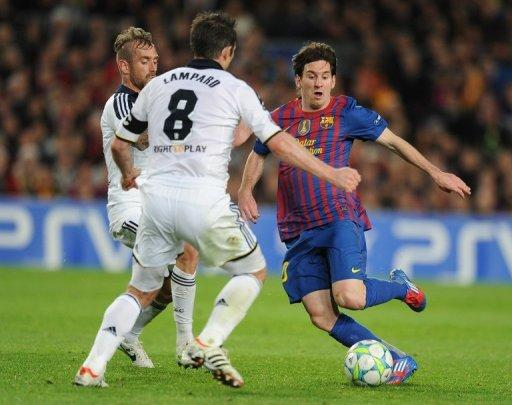 Lionel Messi (right) vies for the ball with Chelsea midfielders Raul Meireles (left) and Frank Lampard