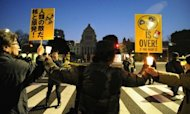 Anti-nuclear activists make a human chain around the National Diet building in Tokyo to protest the Japanese government's nuclear policy on the first anniversary day of the March 11 earthquake and tsunami
