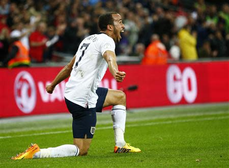 England's Andros Townsend celebrates scoring his team's third goal against Montenegro during their 2014 World Cup qualifying soccer match at Wembley Stadium in London