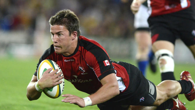 Canada's DTH Van der Merwe scores a try during their rugby union match against the Australian Barbarians on the Gold Coast, Australia, Friday, Aug. 26, 2011. (AP Photo/Steve Holland)