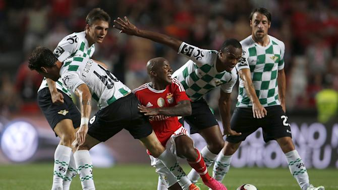 Benfica's Andrade is tackled by Moreirense's Goncalves and Fabiano during their Portuguese premier league soccer match at Luz stadium in Lisbon