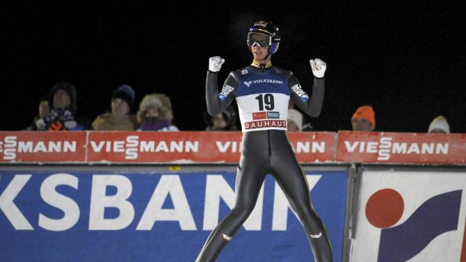 First placed Schlierenzauer of Austria celebrates after the men's Ski Jumping HS 142 Large Hill Individual competition at FIS World Cup Ruka Nordic Opening in Kuusamo