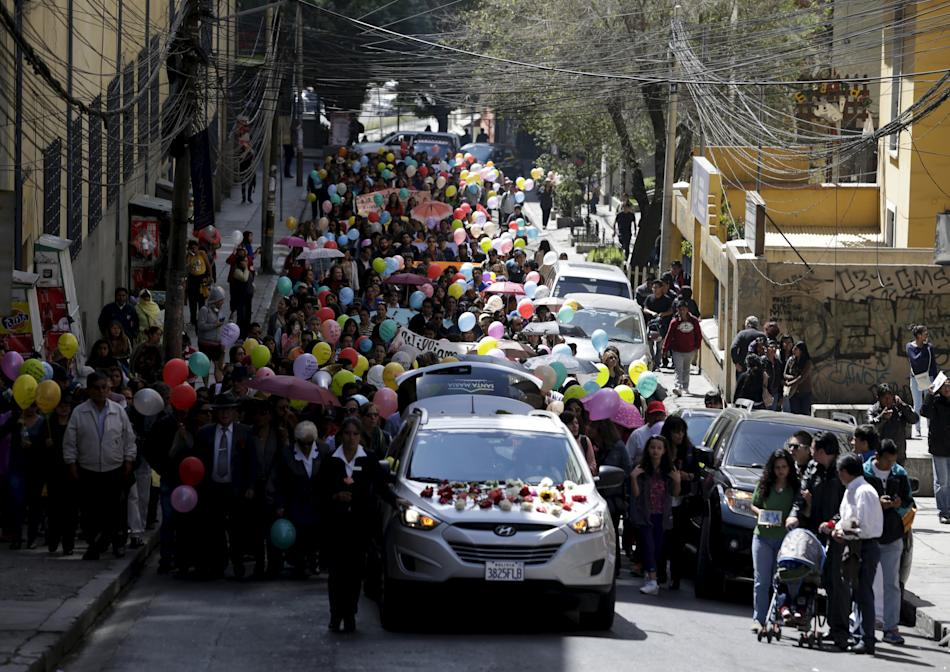 Activists participate in the funeral march of Andrea Alvarez, whose death is being investigated as a femicide in La Paz