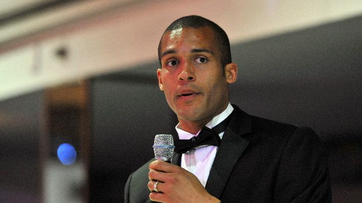 Clarke Carlisle has called for Serbia to be banned from international football if the charges are upheld