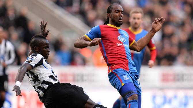 Newcastle United's Tiote challenges Crystal Palace's Jerome during their English Premier League soccer match at St James' Park