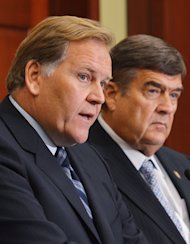 House Intelligence Committee Chairman Mike Rogers (L) speaks as ranking member Rep. Dutch Ruppersberger looks on during a press conference on October 8, 2012 in Washington, DC. The representatives re-introduced the Cyber Intelligence and Sharing Protection Act (CISPA), a bill that passed the House last year but died in the Senate