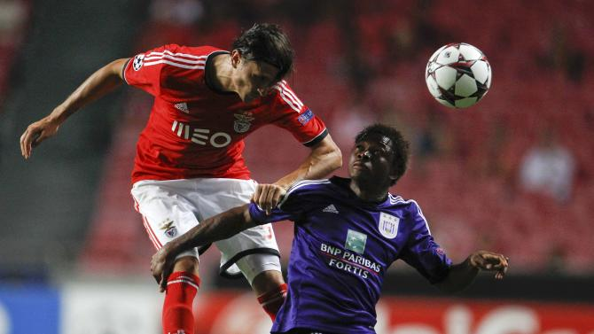 Benfica's Fejsa and Anderlecht's Cyriac fight for the ball during their Champions League soccer match at the Luz Stadium in Lisbon
