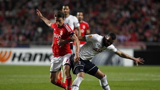 Tottenham's Sandro, from Brazil, tussles for the ball with Benfica's Filip Djuricic, from Serbia, during the Europa League, round of 16, second leg soccer match between Benfica and Tottenham at Benfica's Luz stadium, in Lisbon, Thursday, March 20, 2014. Benfica won 5-3 on aggregate and advances to the next round