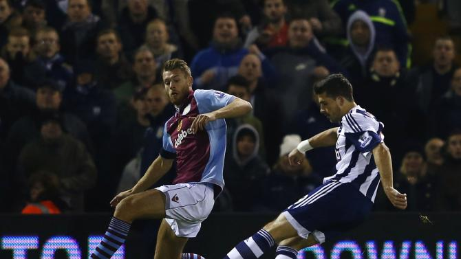 West Bromwich Albion's Shane Long shoots and scores his goal against Aston Villa during their English Premier League soccer match at The Hawthorns in West Bromwich