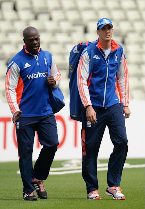 England's Steven Finn with bowling coach Ottis Gibson during a training session