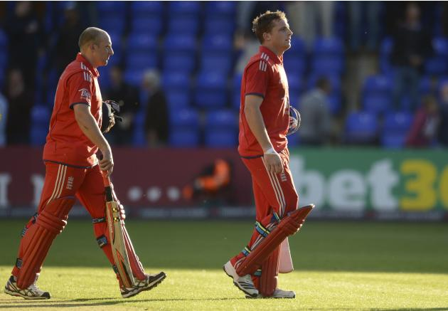 England's Buttler and Tredwell leave the field after winning the fourth one-day international against Australia at Sophia Gardens in Cardiff, Wales
