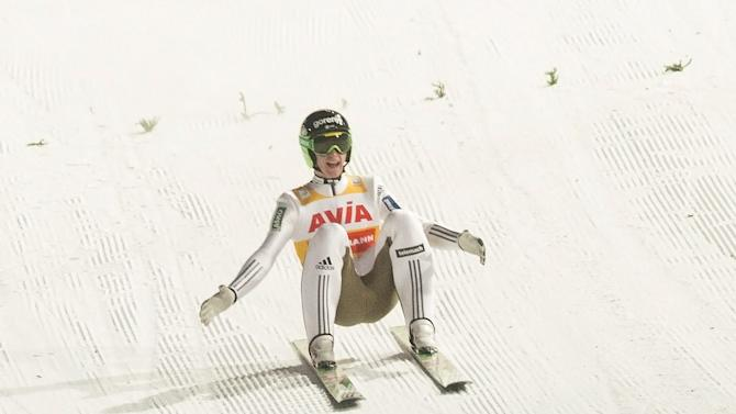 Peter Prevc of Slovenia nearly falls after landing 249m in the final round of the FIS Ski Jumping World Cup Flying Hill competition in Vikersund, Norway