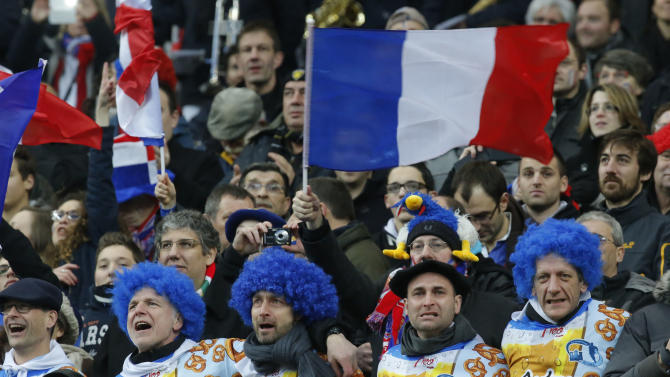 French supporters cheer during the the French National anthem prior to a Six Nations international rugby union match between France and England at Stade de France stadium in Saint Denis, near Paris, Saturday, Feb. 1, 2014. France won against England 26-24. (AP Photo/Michel Euler)