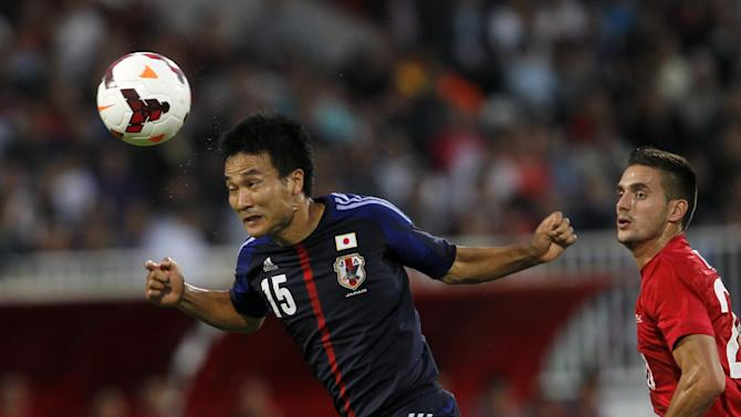 Japan's Yasuyuki Konno, left, heads the ball away from Serbia's Dusan Tadic, right, during Serbian retired soccer player Dejan Stankovic's farewell match, at Karadjordje stadium in Novi Sad, Serbia, Friday, Oct. 11, 2013. Stankovic has played for Red Star Belgrade (1994-1998), Lazio (1998-2004) and Inter Milan (2004-2013). After this match Stankovic will have the largest number of appearances in Serbian national team history