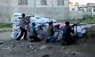 An image grab taken from a video uploaded on YouTube allegedly shows members of the Free Syrian Army (FSA) fighting against government forces in the village of Taldou, near the town of Houla in Syria's Homs province. Russia reported finding agreement with the United States on Syria and voiced optimism that crucial Geneva talks Saturday could bring a shift toward peace after 16 months of bloodshed