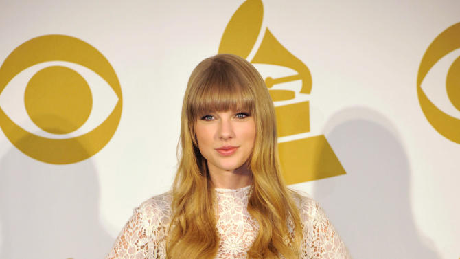 Co-host Taylor Swift poses for a photo at the Grammy Nominations Concert Live! at Bridgestone Arena on Wednesday, Dec. 5, 2012, in Nashville, Tenn. (Photo by Donn Jones/Invision/AP)