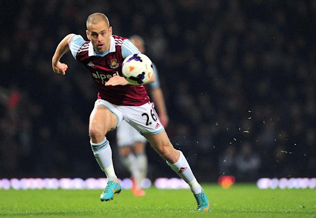 Joe Cole runs after the ball during West Ham United's English Premier League football match againt Hull City in East London, England, on March 26, 2014