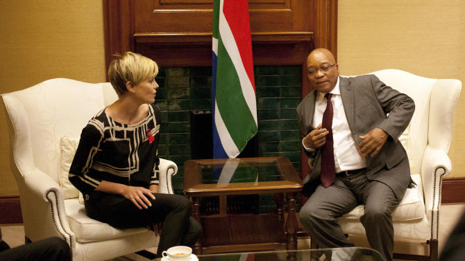 "South African President Jacob Zuma, right, meets South African-born Hollywood actress Charlize Theron, left, at his Union Building office in Pretoria, South Africa, Monday, 29 July 2013, ahead of their meeting, to discuss the fight against HIV and Aids, and ""how collaboration can assist mitigate the pandemic's negative impact on young girls"". (AP Photo/Themba Hadebe)"