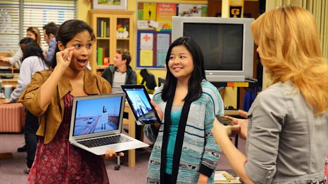 "This publicity image released by ABC Family shows Karla Gutierrez, left, and Ashley Shimizu in a scene from ABC Family's TV series, ""Switched at Birth."" When news of the school's closing spreads, the students of Carlton School for the Deaf stage a protest. (AP Photo/ABC Family/Eric McCandless)"