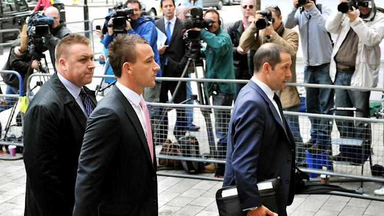John Terry (right) arrives at Westminster Magistrates' Court on Wednesday morning