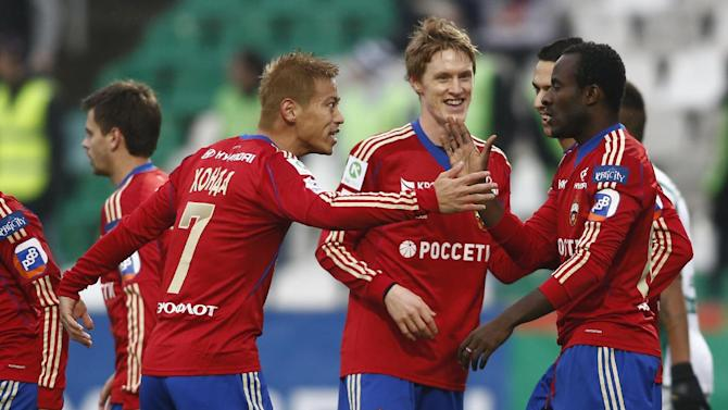 CSKA Moscow's Keisuke Honda, second left, and his teammates celebrate after scoring a goal during a Russian Premier League Championship soccer match between CSKA Moscow and Terek Grozny at a stadium in Moscow, Russia, Sunday, Nov. 10, 2013. CSKA won 4-1