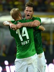 Bremen's Austrian striker Marko Arnautovic (R) and Bremen's midfielder Aaron Hunt celebrate after their team scored the 1-1 during the German first division Bundesliga football match Borussia Dortmund vs Werder Bremen. In the end Dortmund won 2-1