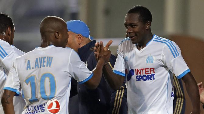 Olympique Marseille's Imbula reacts with teammate Ayew after scoring against Saint Etienne during French Ligue 1 soccer match in Marseille