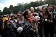 Protesters shout slogans during a demonstration in Gazi Park, next to Taksim Square, in Istanbul on June 7, 2013. Hotel reservations may be down after a week of violent mass protests in Turkey, but plucky tourists on the ground have taken the unrest in their stride