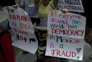 Tens of thousands of demonstrators marched through Mexico City Saturday against the presidential election win of Enrique Pena Nieto, accusing him and his party of widespread vote-buying
