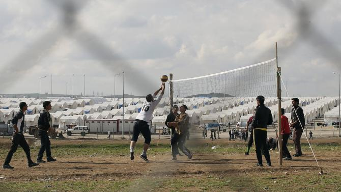 Yazidi refugees play volleyball at Sharya refugee camp on the outskirts of Duhok