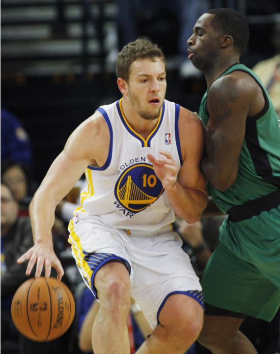 Golden State Warriors' David Lee drives toward the basket as Boston Celtics' Brandon Bass defends during the first half of an NBA basketball game in Oakland, Calif., Saturday, Dec. 29, 2012. (AP Photo