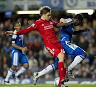 Chelsea's Belgian striker Romelu Lukaku (R) vies for the ball against Liverpool's Sebastian Coates (C) during the League Cup 5th round football match between Chelsea and Liverpool at Stamford Bridge in London. Liverpool won 2-0