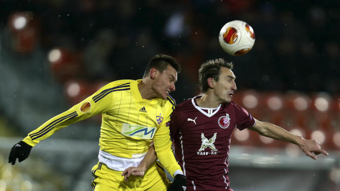 Rubin's Ruslan Mukhametshin, right,  fights for the ball with Maribor's Arghus during their Europa League Group D soccer match in Kazan, Russia, Thursday, Nov. 28, 2013
